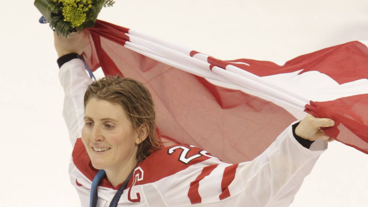 Pix from Canada's 2-0 victory over the USA in the gold medal game played at Canada Hockey Place in Vancouver during the 2010 Olympic Games. Canada's Hayley Wickenheiser with the flag. (Photo by Peter Power / The Globe and Mail)