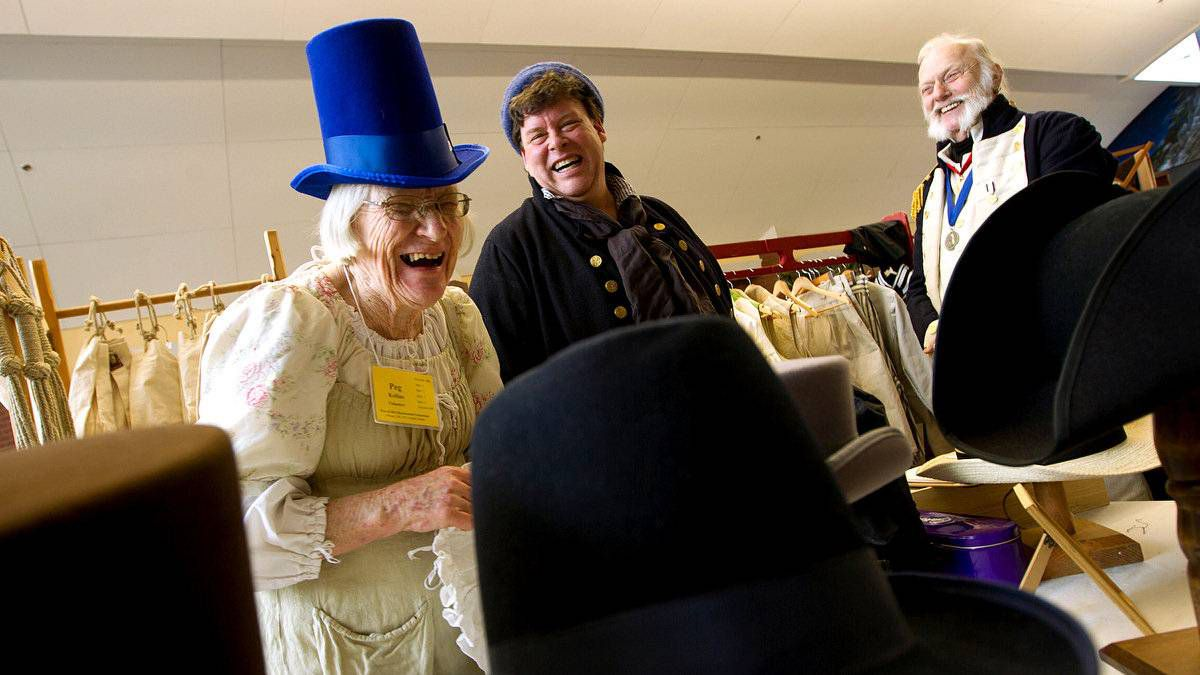 Peg Kellins, of Clinton, Ont., tries on a man's hat to the delight of Glendon Hovey, centre, and Andre Reed.