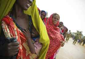 A woman holds her malnourished baby in a camp established by the Somali Transitional Federal Government (TFG) for internally displaced people in Mogadishu.