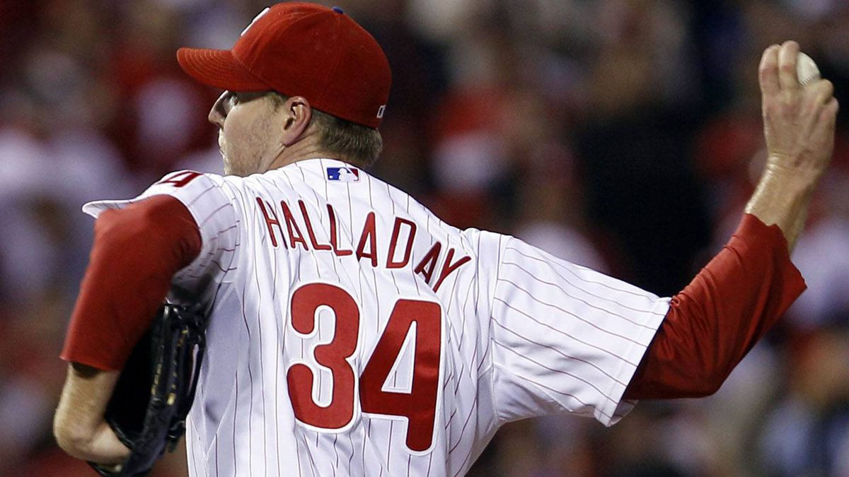 Philadelphia Phillies starting pitcher Roy Halladay throws the ball during the first inning of baseball's Game 5 of the National League division series with the St. Louis Cardinals Friday, Oct. 7, 2011 in Philadelphia. (AP Photo/Matt Rourke)