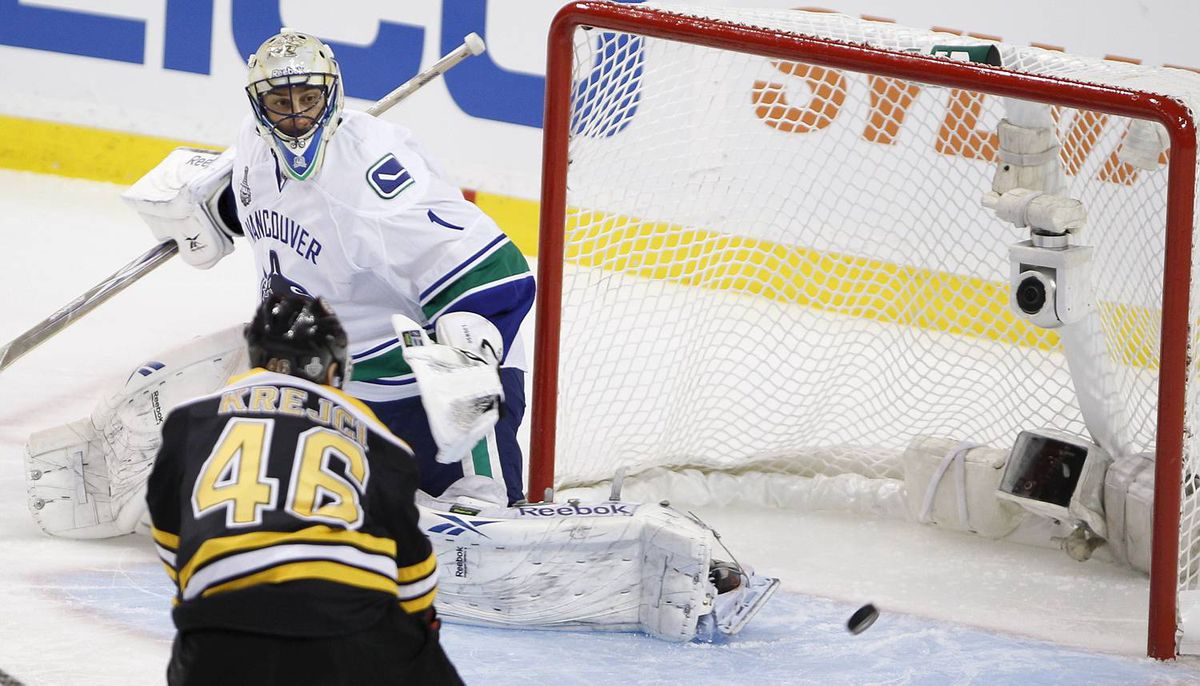 Boston Bruins' David Krejci watches puck go past Vancouver Canucks Roberto Luongo during the first period of the NHL Stanley Cup Final Game 6 in Boston on June 13, 2011. (Photo by Peter Power/The Globe and Mail)