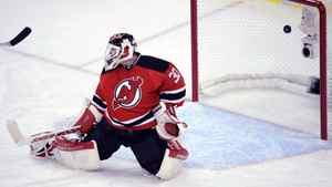 New Jersey Devils goalie Martin Brodeur lets in a goal by New York Rangers' Dan Girardi during the third period in game 3 of their NHL Eastern Conference Final in Newark, New Jersey, May 19, 2012.