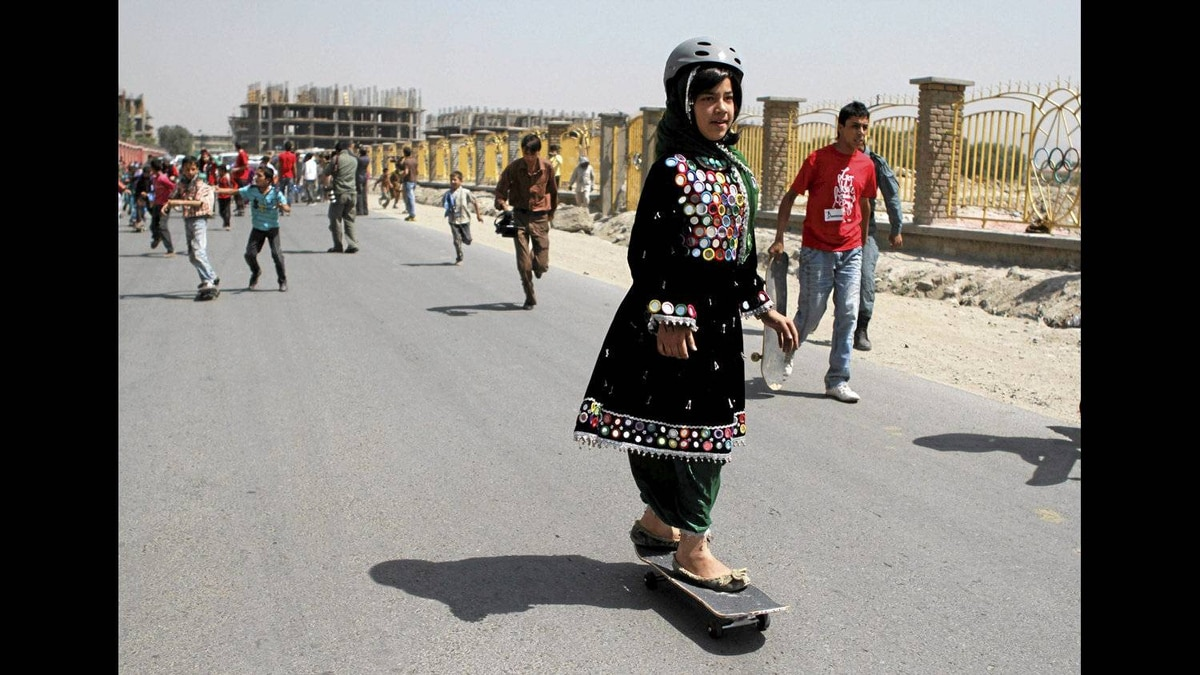 A girl takes part in a skateboarding competition to mark the third annual Go Skateboarding Day in Kabul on June 21.