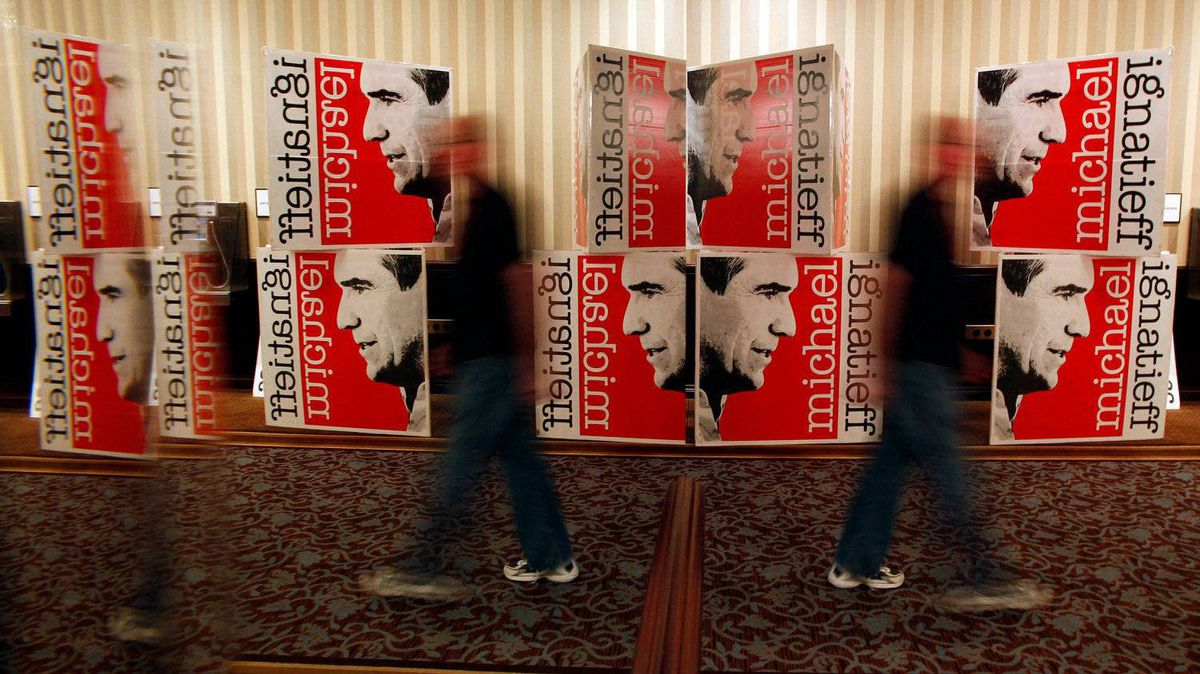 A man walks past some of the signage decorating the hallways around the Grand Ballroom where Michael Ignatieff and Liberal supporters will gather on election night in Toronto on May 2, 2011.