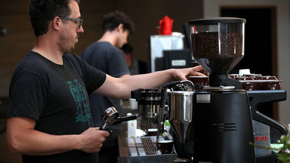 A barista at Sightglass Coffee makes a coffee drink in San Francisco.
