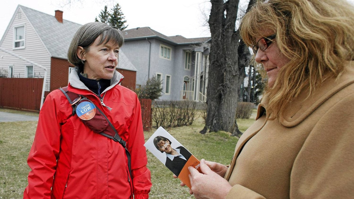 Calgary-Mountain View PC candidate Cecilia Low meets Mary Ann Wright in her riding on Tuesday, April 17, 2012