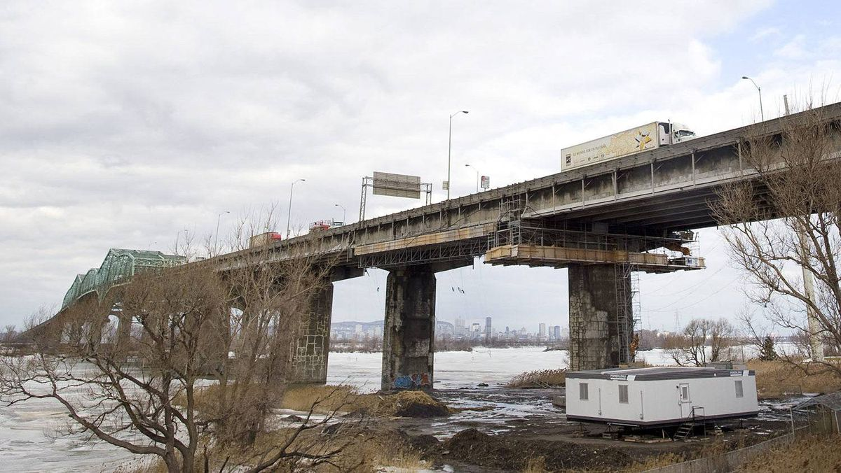 Maintenance crews work on the Champlain Bridge as it spans the Saint Lawerence river in Montreal, Friday, March 18, 2011. Now Canada's busiest bridge with up to 60 million vehicles crossing per year since opening to traffic in 1961, the bridge is in need of major repair and has become a safety concern to motorists.