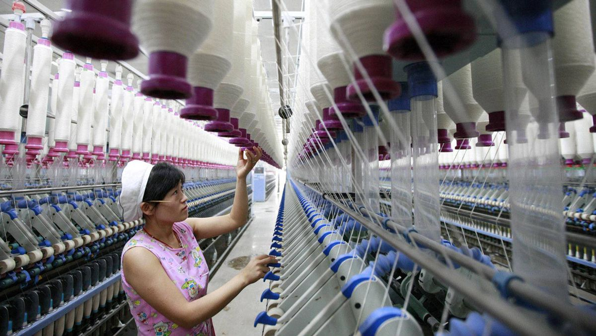 A labourer works at a textile mill in Huaibei, Anhui province.