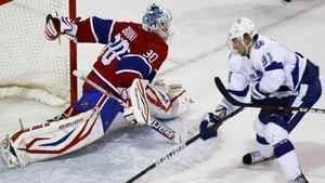 Montreal Canadiens goalie Peter Budaj (30) makes a save on Tampa Bay Lightning center Steven Stamkos (91) during the second period of NHL hockey action in Montreal, April 4, 2012.