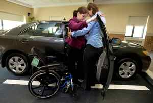 Physiotherapist Angela Gliatta, right, helps teach rehab patient Kathe Akbar how to safely enter a vehicle in the Toyota Canada Motor Skills Clinic at the Providence Healthcare facility in Toronto on Wednesday, June 3, 2009.