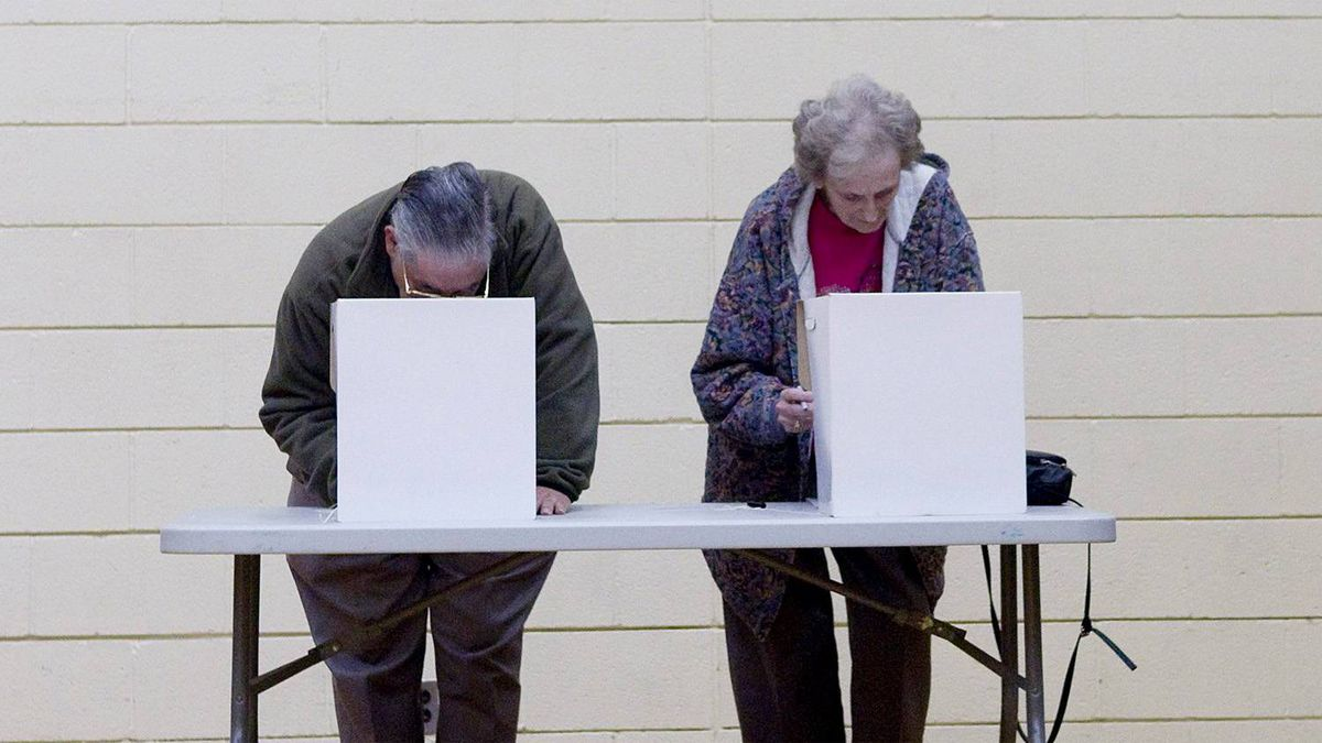 Voters mark their ballot papers in the municipal election in Toronto on Monday.