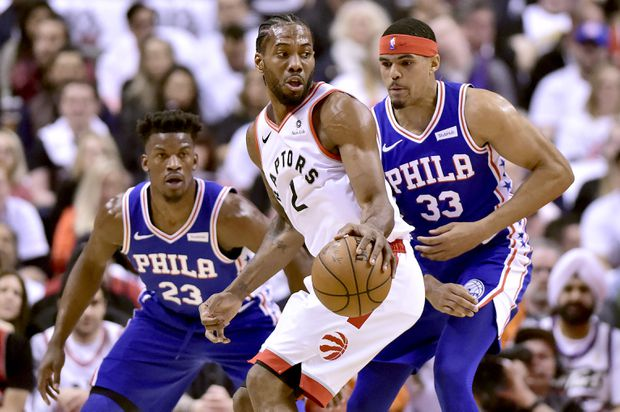 da512c317d28 Toronto Raptors forward Kawhi Leonard (2) moves the ball as Philadelphia  76ers guard Jimmy Butler (23) and teammate Tobias Harris (33) look on  during first ...
