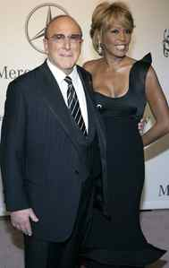 Clive Davis, shown with Ms. Houston in 1996, was the singer's mentor after he discovered her singing in her mother's act in a club.