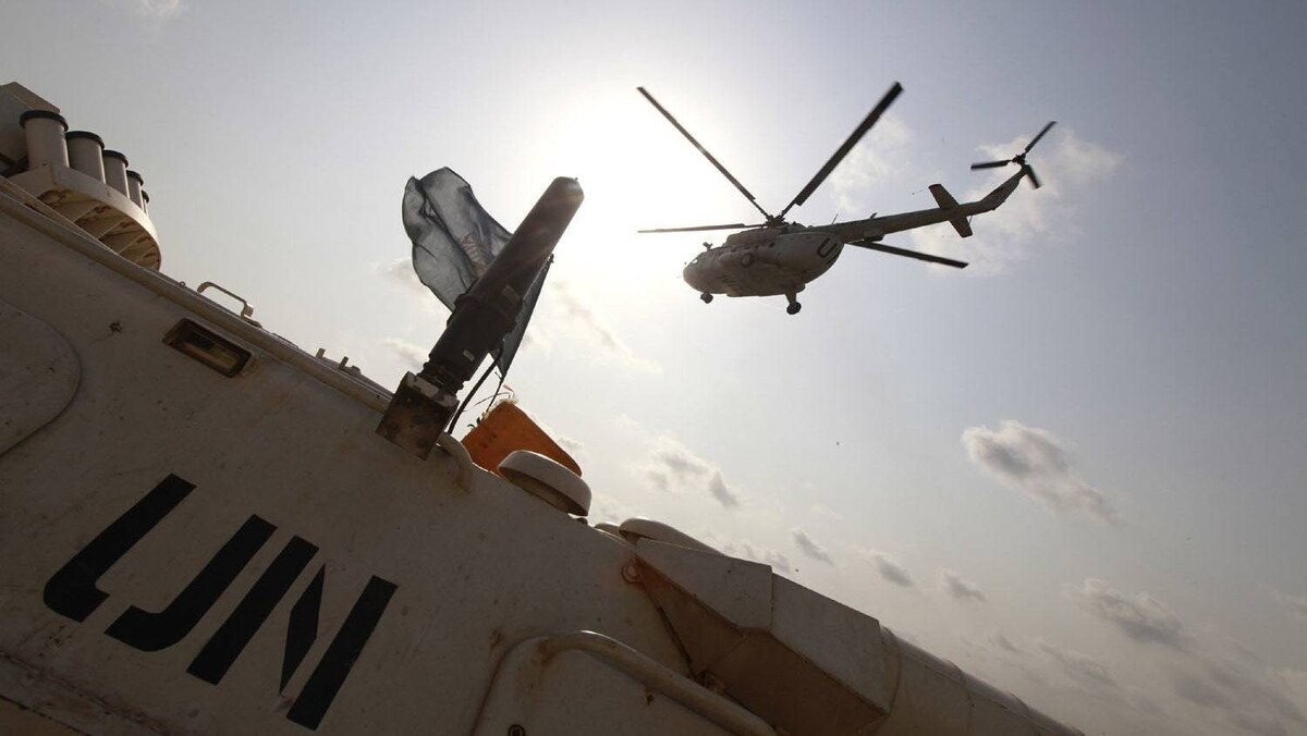 A United Nations helicopter carrying journalists to a news conference held by Alassane Ouattara takes off from the UN headquarters in Abidjan Dec. 24, 2010.