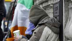 Homeless people beg for change in central Dublin on Nov. 16, 2010.
