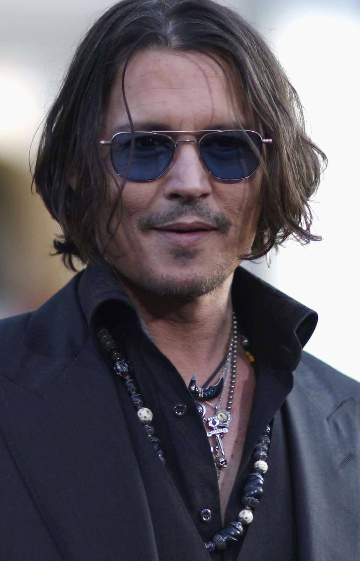 And now for a quick man-bangles contest featuring Johnny Depp vs. Steven Tyler of Aerosmith, I mean American Idol. Depp sports wooden beads, what appears to be a tiny sideways dagger, a skull and some sort of key. There are at least five different necklaces in play.