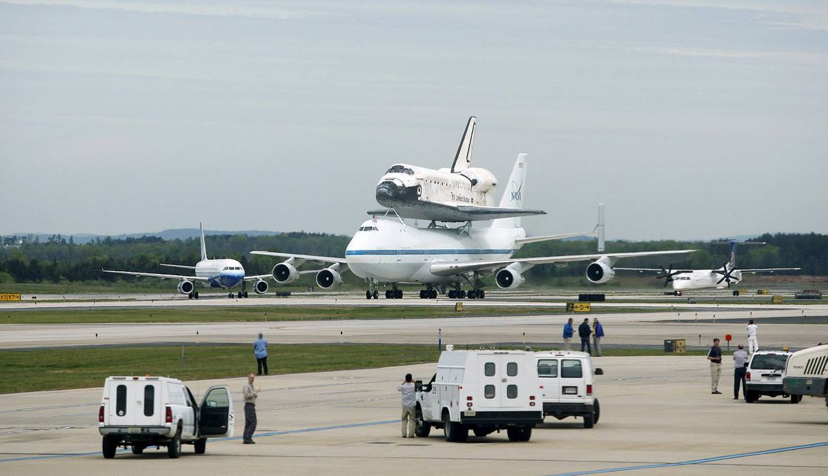 Discovery, riding atop a NASA 747 transport jet, taxis after arriving at Dulles International Airport in Virginia