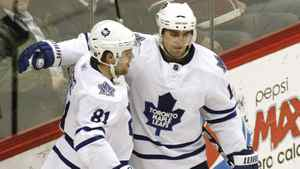 Toronto Maple Leaf winger Phil Kessel (L) celebrates scoring in the third period with teammate Joffrey Lupul against the Colorado Avalanche during their NHL hockey game in Denver March 24, 2011.