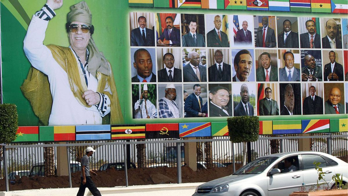 A huge picture of Libyan leader Moammar Gadhafi and other African leaders adorns a street in the Libyan city of Sirte.