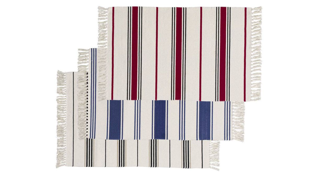 Don't let their low price fool you – these handsome flat-woven area rugs are just the thing for a long, dark hallway; line up three of them to make such a space feel shorter. Multi-coloured Signe rugs, $2.99 each at IKEA.