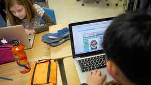Schoolchildren use laptops connected to a wireless network. Charla Jones/The Globe and Mail