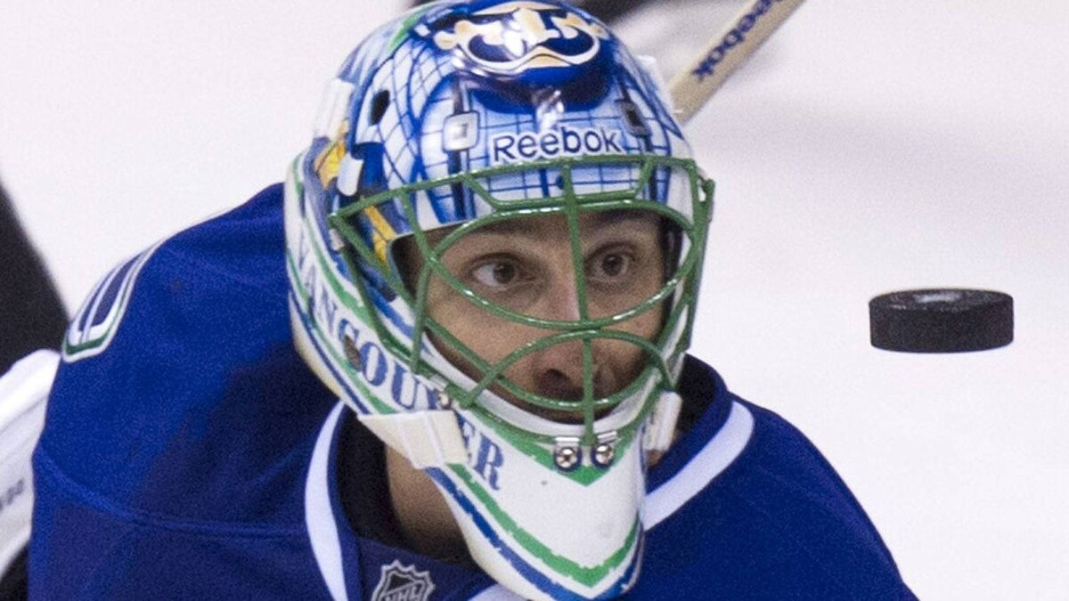Vancouver Canucks goaltender Roberto Luongo watches a shot from the L.A Kings during NHL playoff action in Vancouver April 13, 2012. (John Lehmann/The Globe and Mail)