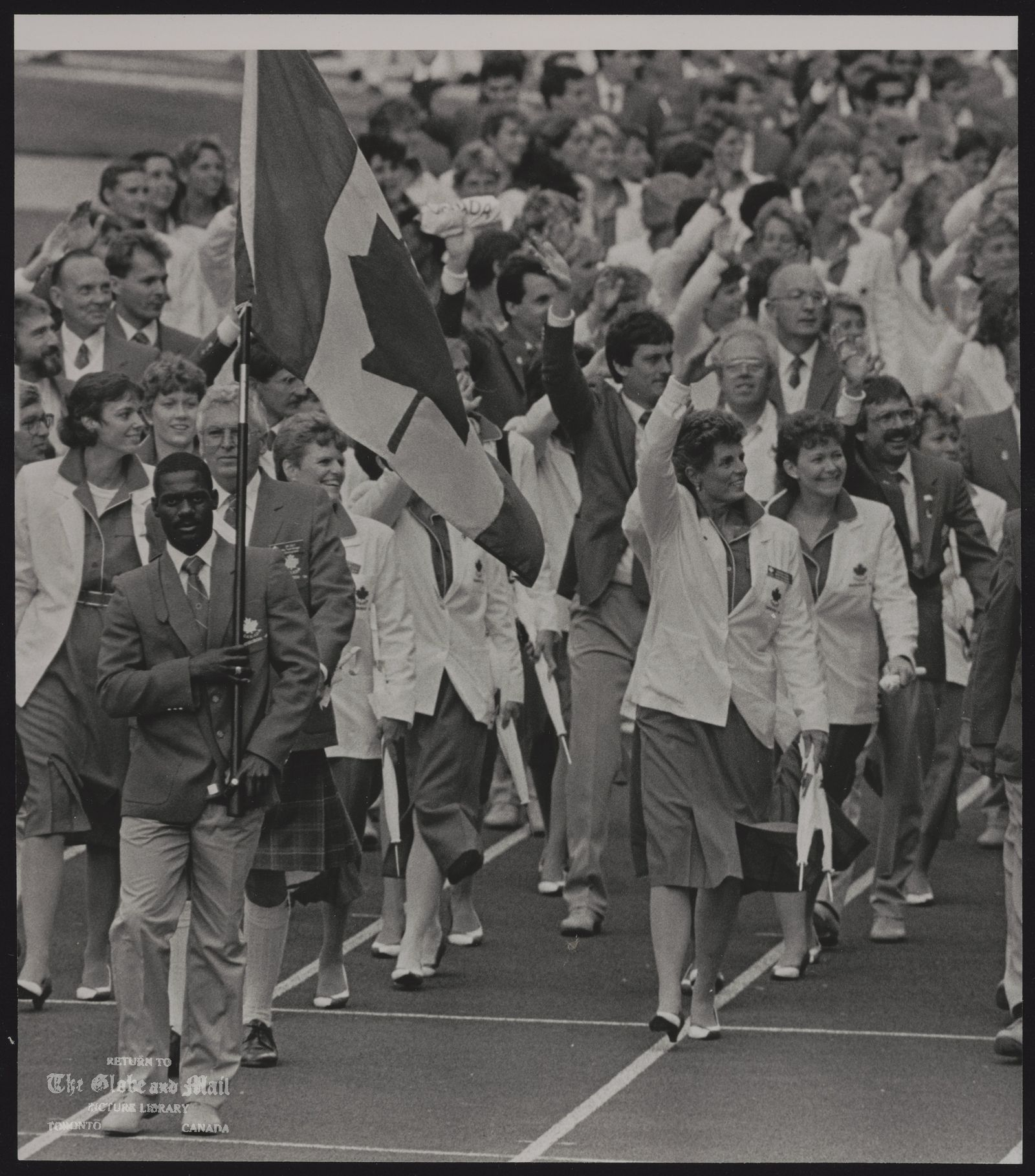 COMMONWEALTH GAMES EDINBURGH 1986 EDIO6:SPECIAL FOR THE GLOBE AND MAIL, CANADA EDINBURGH; SCOTLAND, JULY 24-Canadian flag bearer Ben Johnson leads the team onto the field during opening ceremonies here 7/24 REUTER hd/Hans Deryk