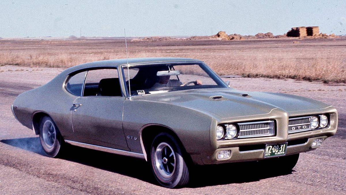 My first car. 1969 GTO, 400 cu in, high rise 4 barrel holley car. Lots of horsepower and just a great car. Unfortunately got totalled by a jack-knifed semi that tore the passenger side off the car.