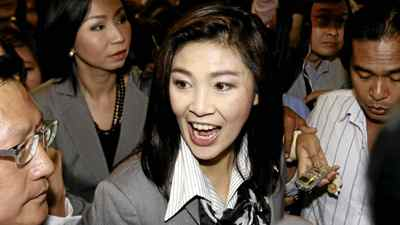 Yingluck Shinawatra, the leader of Pheu Thai Party, talks with reporters upon her arrival at a hotel for a meeting with leaders of the coalition partners on Monday, July 4, 2011 in Bangkok.