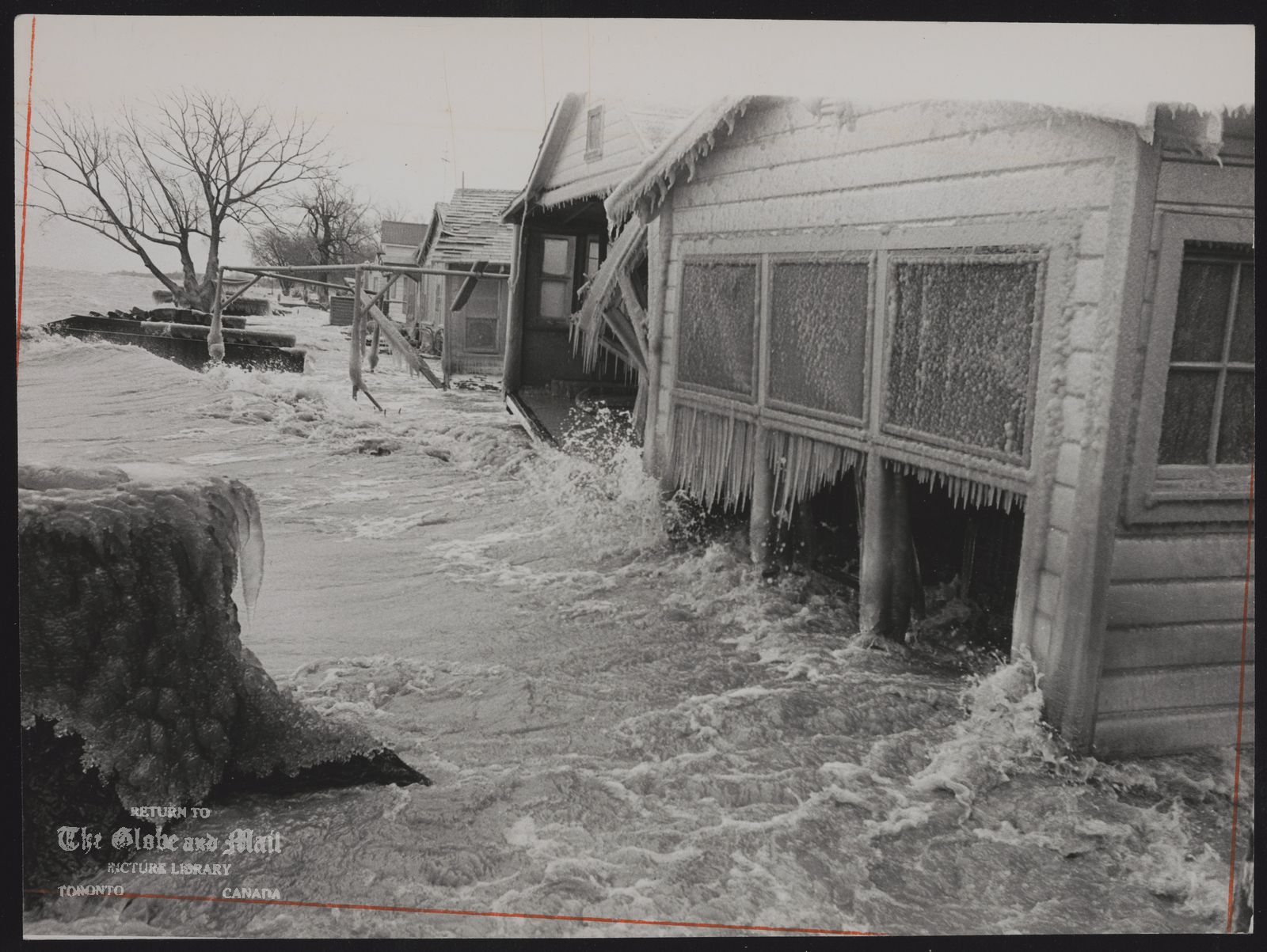 FLOODS Canada (Lake St.Clair waves pour in throuh the broken windows of Albert Konopski's wrecked cottage; one of many damaged on St. Pierre Beach Road, west of Belle River yesterday.)