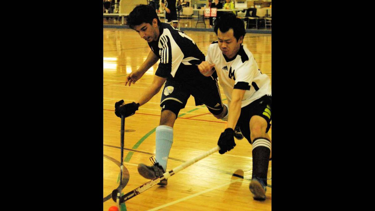 Jordan of the Maroons (right) battles Balmeet of U18 Alberta for the ball at the Alberta Cup for Field Hockey in Calgary, AB.