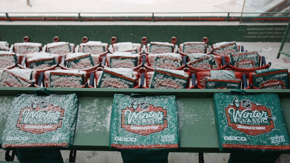 Snow covers the seat cushions before the Bridgestone NHL Winter Classic on December 31, 2009 at Fenway Park in Boston, Massachusetts. (Photo by Elsa/Getty Images)