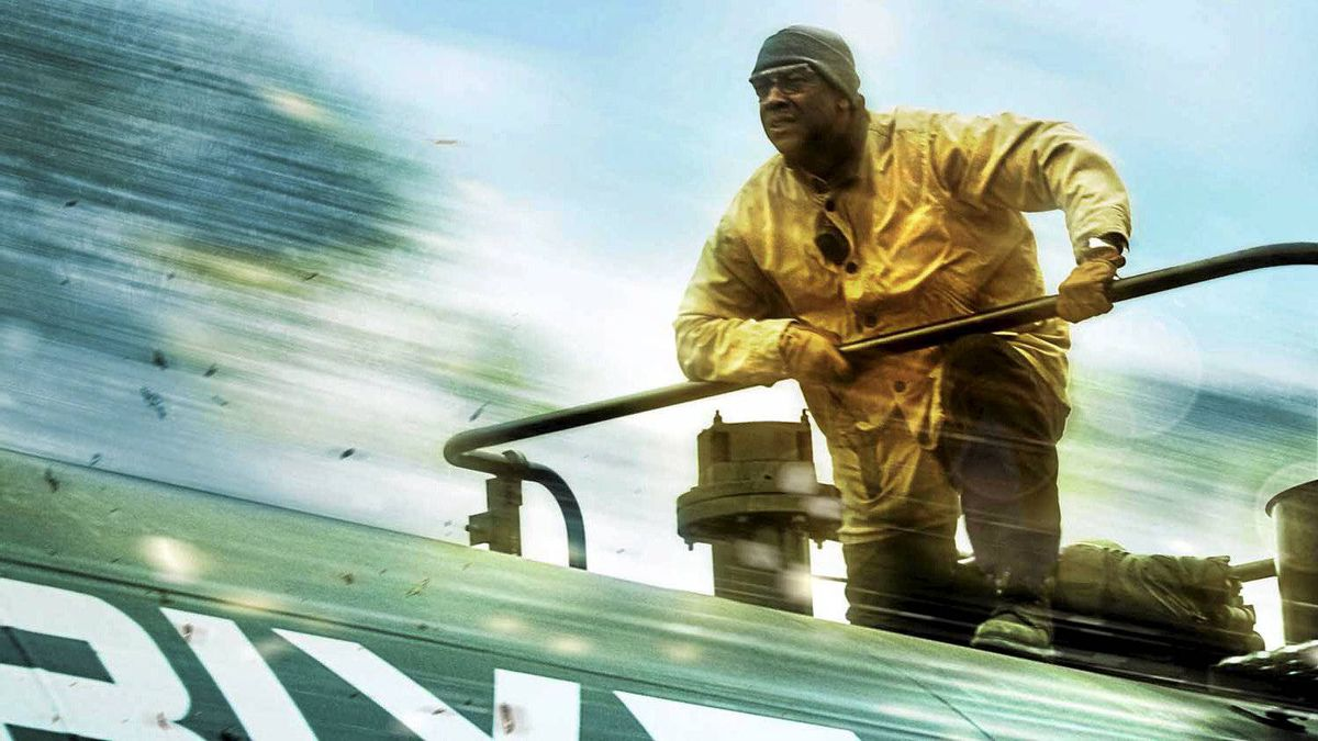 Denzel Washington surfs a runaway train in a scene from Unstoppable.