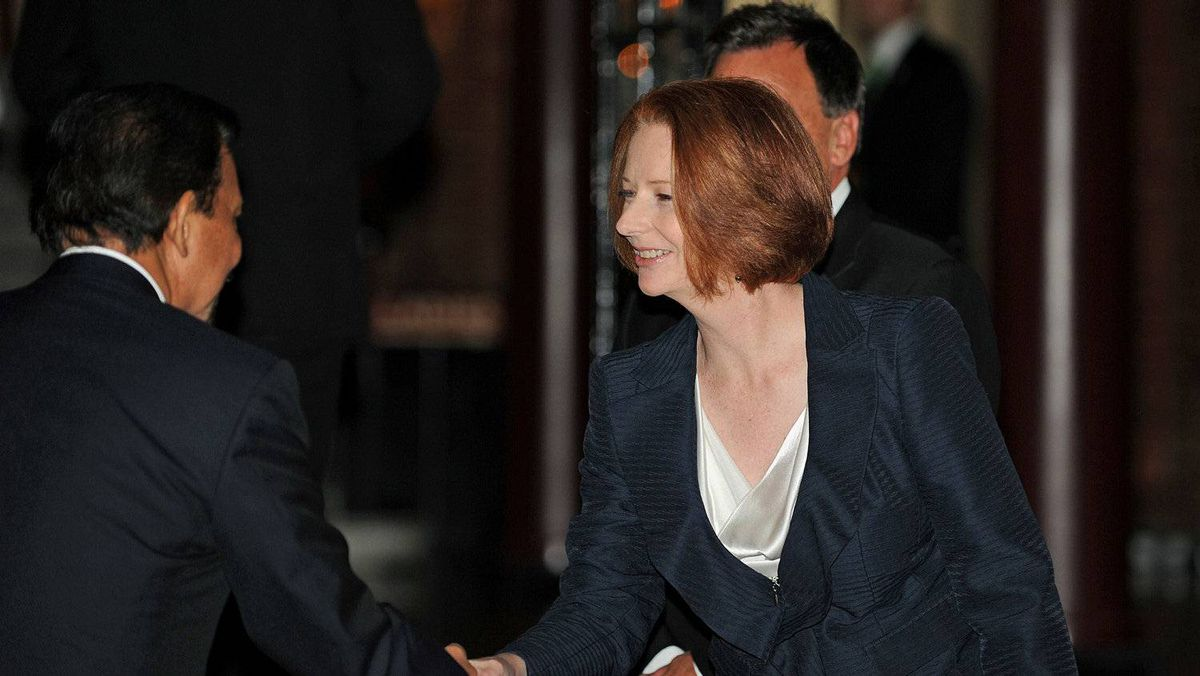 Australian Prime Minister Julia Gillard (C) welcomes a dignitary to the Commonwealth Heads of Government Meeting (CHOGM) dinner at the University of Western Australia in Perth on October 29, 2011. Commonwealth leaders failed to establish a human rights watchdog for their 54-nation bloc, but insisted that progress had been made during their summit to promote democratic values.