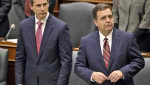 Ontario Premier Dalton McGuinty and Finance Minister stand in the Legislature at Queen's Park after the Throne Speech on Nov. 22, 2011.