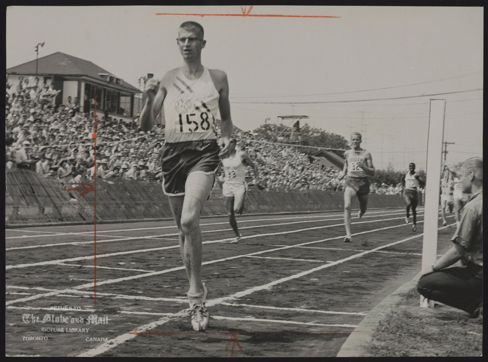 The notes transcribed from the back of this photograph are as follows: Bill CROTHERS Sprinter Bill Crothers of East York hits finish line in record time for 800-yard run. Crothers clocked 1:49.0, 0.6 seconds better than record held by Ergas Leps of Toronto. Leps was sixth yesterday. Trailing Crothers are Siq Ohleman (32) and Don Bertaio (33) both from Vancouver.
