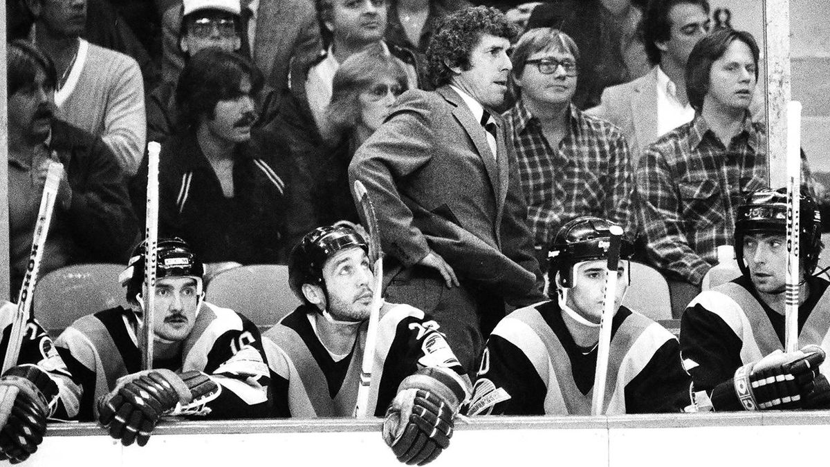 Roger Neilson head coach of the Vancouver Canucks watches action from behind bench in game against the Boston Bruins at Boston Garden.