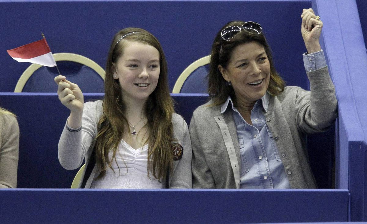 Princess Caroline of Hanover and her daughter Alxandra react after the performance of Monaco's skater Kim Lucine in the men's free skating event at the 2012 World Figure skating Championships in Nice, southern France, Saturday, March 31, 2012.