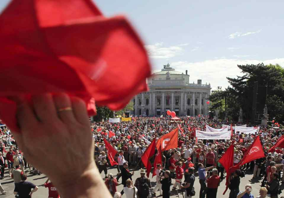 People gather at the Rathausplatz in front of the Burgtheater during the Austrian Social Democrats' May Day celebrations in Vienna.