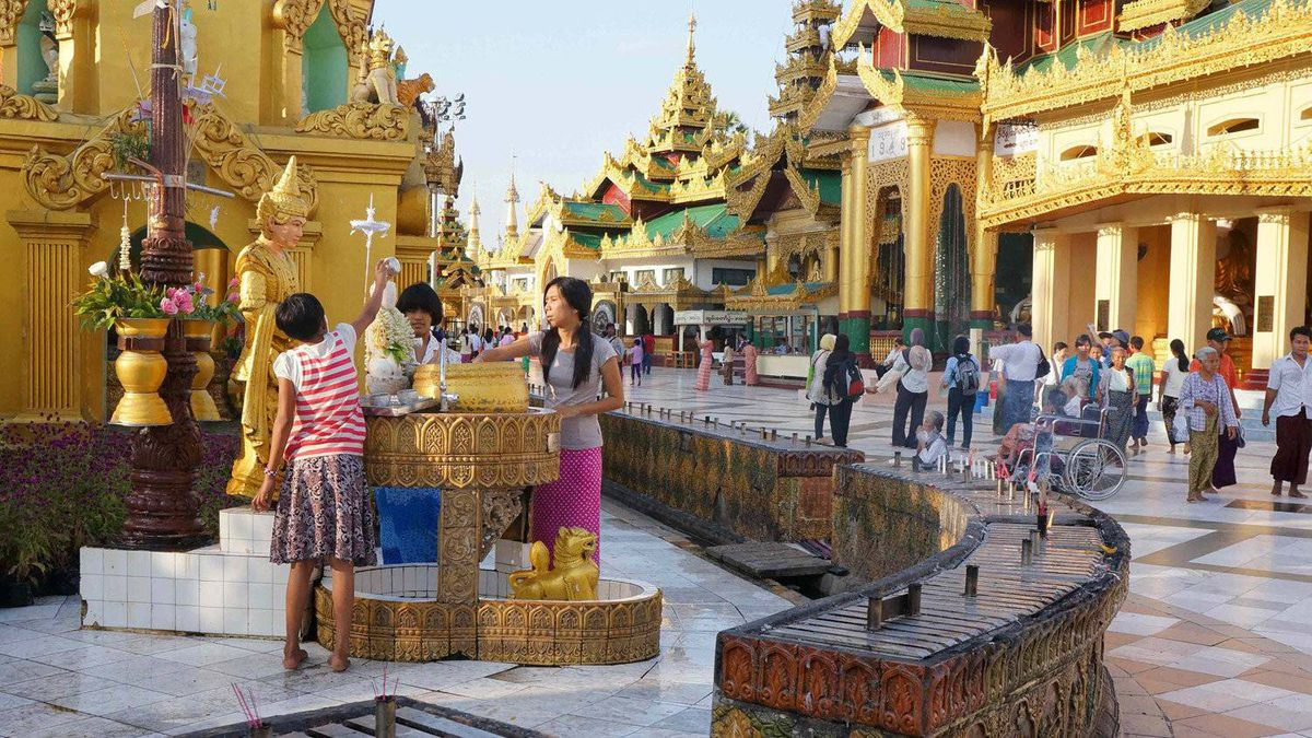 Buddhists young and old visit the Shwedagon pagoda in Yangon.