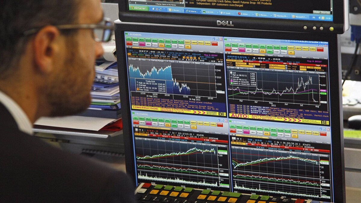A stock trader looks on the graph displaying activity on the French Stock Exchange, in Paris, Tuesday, Aug. 16, 2011.
