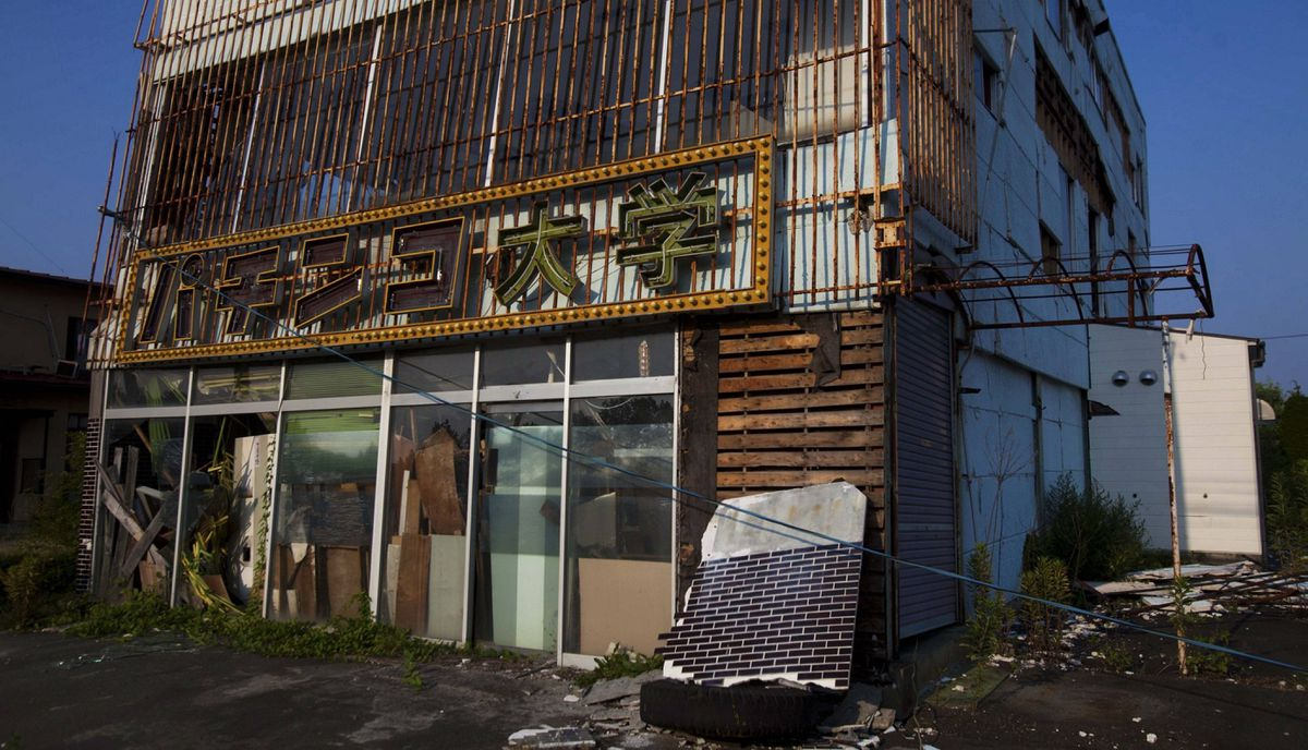 An abandoned pachinko parlor sits along highway 6 near Tomioka, inside the 20-kilometer exclusion zone around the Fukushima Daiichi nuclear plant July 16, 2011. A year after the Tsunami, cleanup has begun, but experts say areas inside the nuclear exclusion zone will be difficult to decontaminate.