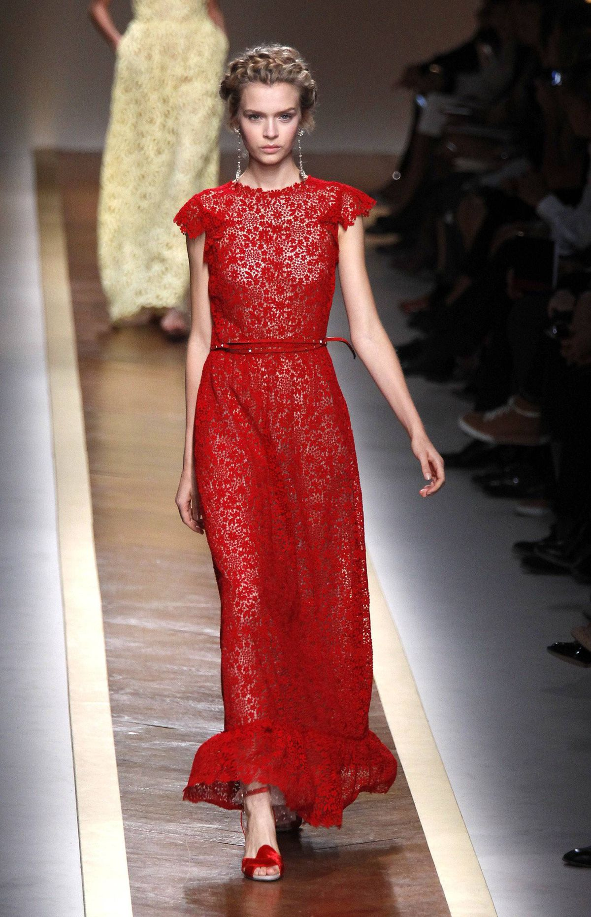 A Valentino collection is never complete without a smattering of red dresses. One short, strapless number – strong in its simplicity – was utterly minimalist in the context of the collection. More typical is this full-length frock. Awards season is right around the corner, after all, and the designers made sure to offer enough red-carpet variety.