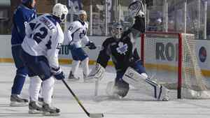 Toronto Maple Leafs goaltender Jonas Gustavsson makes a save during a team outdoor practice at Sunnydale rink in Toronto Jan. 4, 2012.