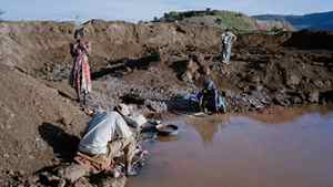 Artisan miners use mercury to extract gold deposits from rocks crushed by hand.