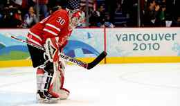 Canada's Martin Brodeur hangs his head after allowing the fourth U.S. goal at Canada Hockey Place in Vancouver , Sunday.