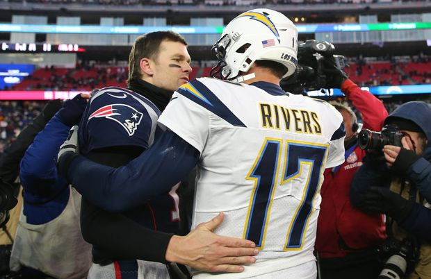 New England Patriots quarterback Tom Brady hugs Los Angeles Chargers  quarterback Philip Rivers after an AFC divisional playoff game f1902502c