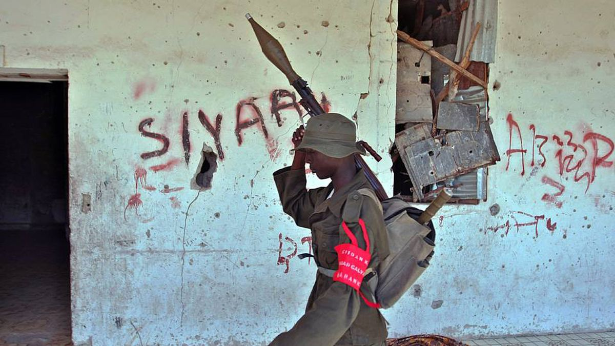 A soldier from the newly formed anti crime squad, armed with a rocket launcher, conducts a search for illegal weapons on September 5, 2009 in Mogadishu.