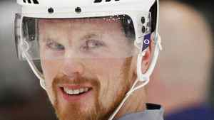 Vancouver Canucks' Daniel Sedin unbuckles his helmet strap as he leaves the ice after a practice for Game 4 of the team's NHL Western Conference quarter-final hockey playoff against the Los Angeles Kings at the Kings' practice facility in El Segundo, California April 17, 2012. REUTERS/Danny Moloshok