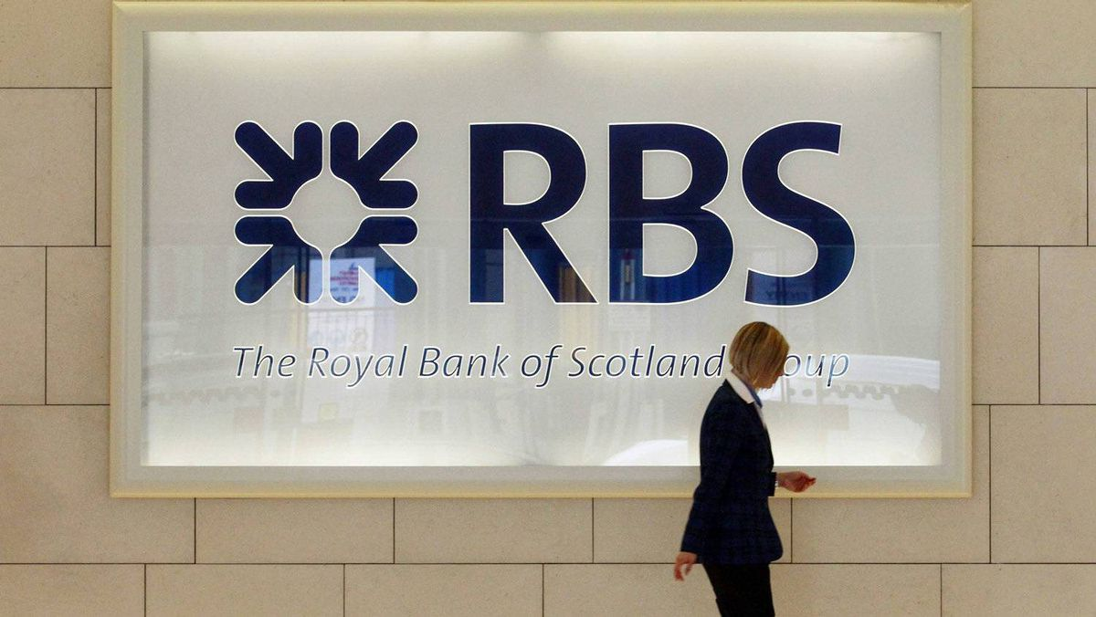 A worker walks in the foyer of a Royal Bank of Scotland (RBS) office in the City of London.